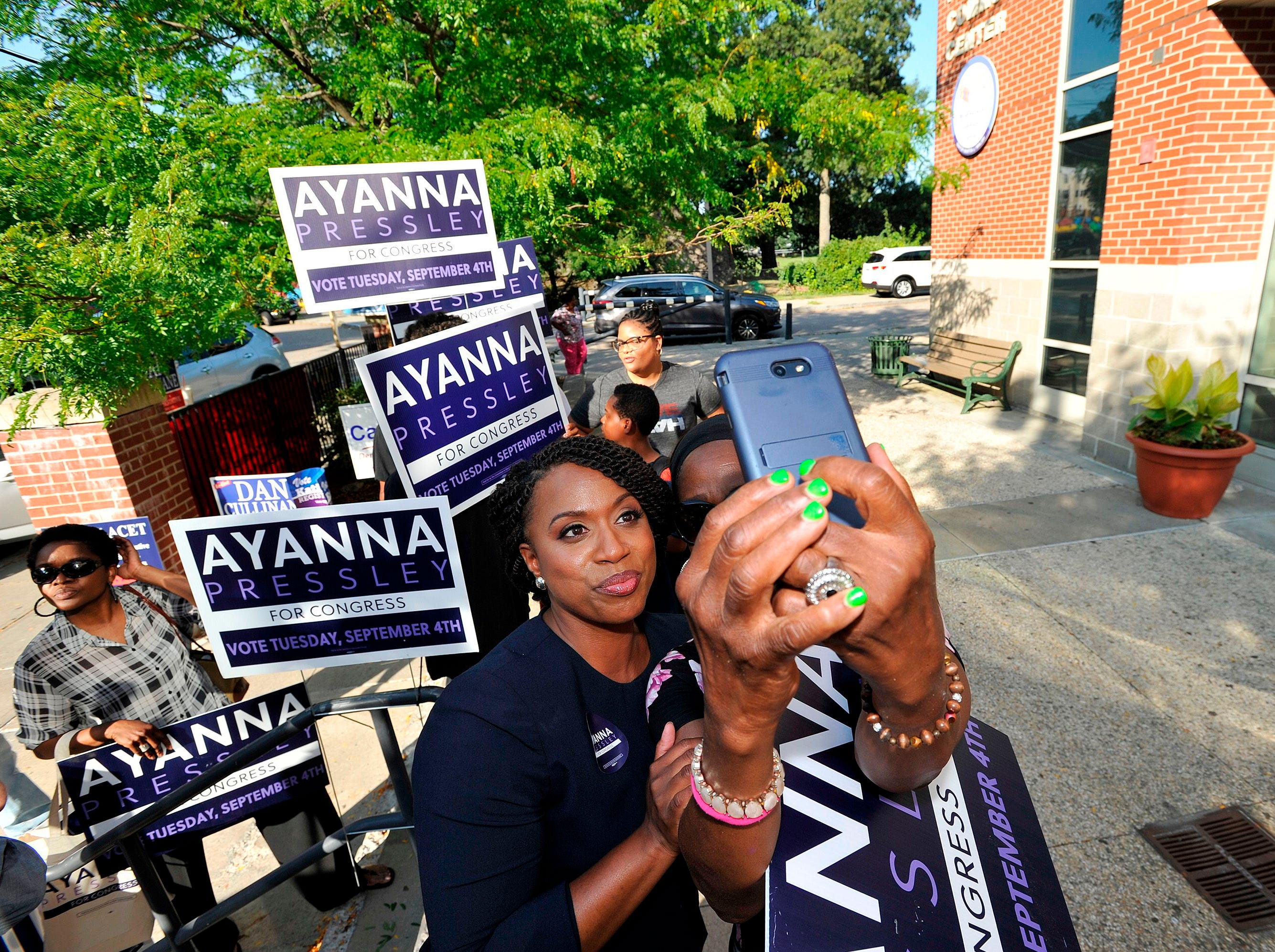 Ayanna Pressley, Democratic candidate for Congress,  takes a selfie with a supporter at the Mildred Middle School and Community Center in Boston, that served as a polling station for primary election on September 4, 2018.
