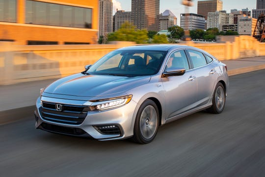 This undated photo provided by American Honda Motor Co. shows the 2019 Honda Insight, which returns to the U.S. after a five-year absence and now more closely resembles Honda's Civic and Accord models. (Courtesy of American Honda Motor Co. via AP)