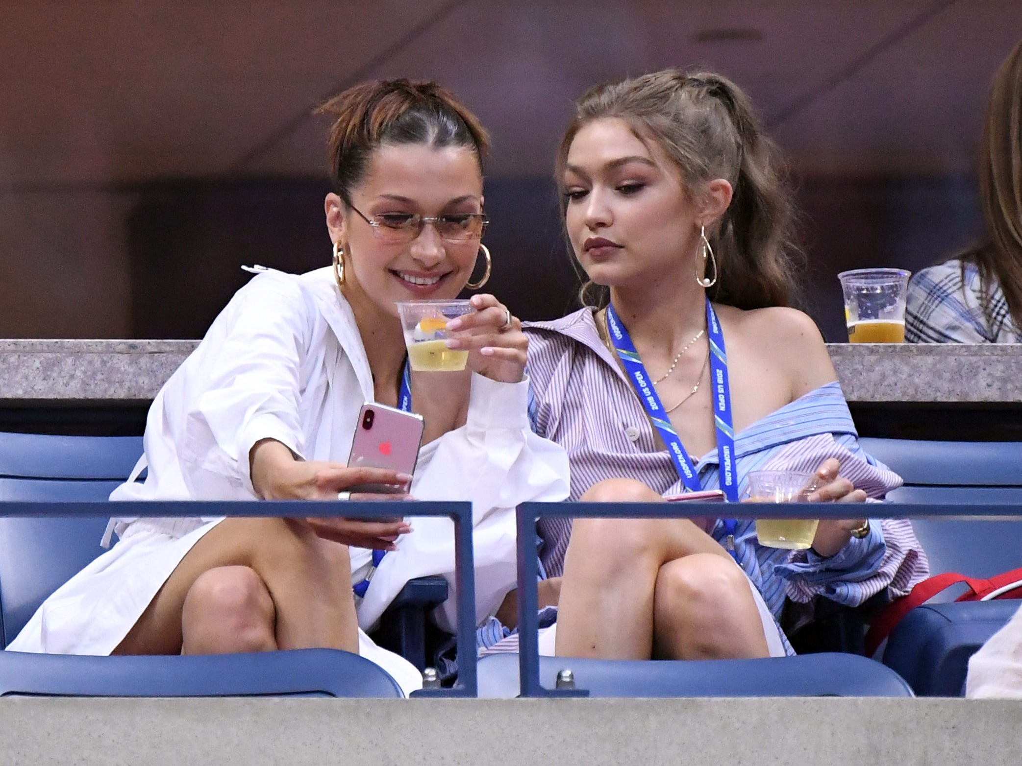 Models Bella Hadid, left, and Gigi Hadid take a selfie before Serena Williams faces Karolina Pliskova in a quarterfinal match.