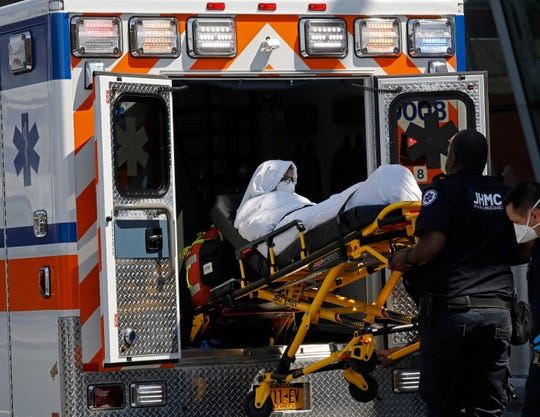 A passenger from Emirates Flight 203 from Dubai that landed at JFK International Airport this morning is transported on a stretcher by paramedics to an ambulance at New York's Kennedy Airport, Sept. 5, 2018.