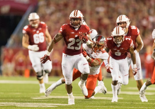 Wisconsin running back Jonathan Taylor breaks free for a touchdown against Western Kentucky in the team's opener.