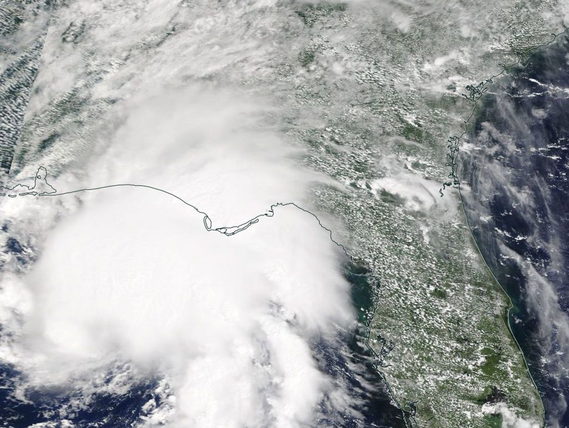 A handout photo of a satellite image made available by the National Aeronautics and Space Administration shows Tropical Storm Gordon making landfall on the border of the US states Alabama and Mississippi on 4 September 2018 (issued 5 September 2018).