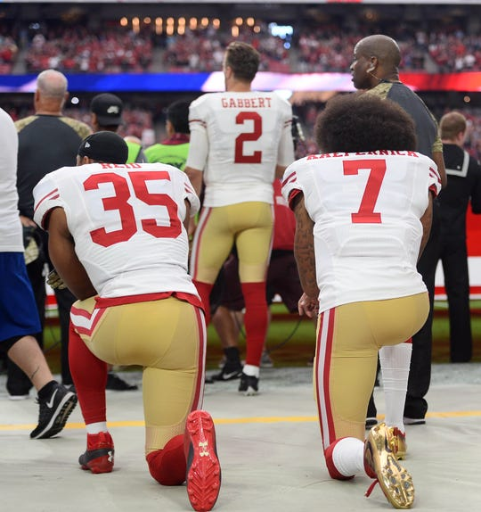 Eric Reid and Colin Kaepernick kneel during the national anthem before a game during the 2016 season.