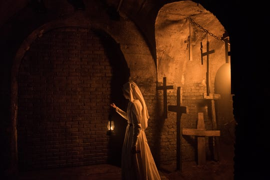 """Sister Irene (Taissa Farmiga) navigates a corridor of crosses - the scene of a supernatural encounter for """"The Nun"""" director Corin Hardy."""