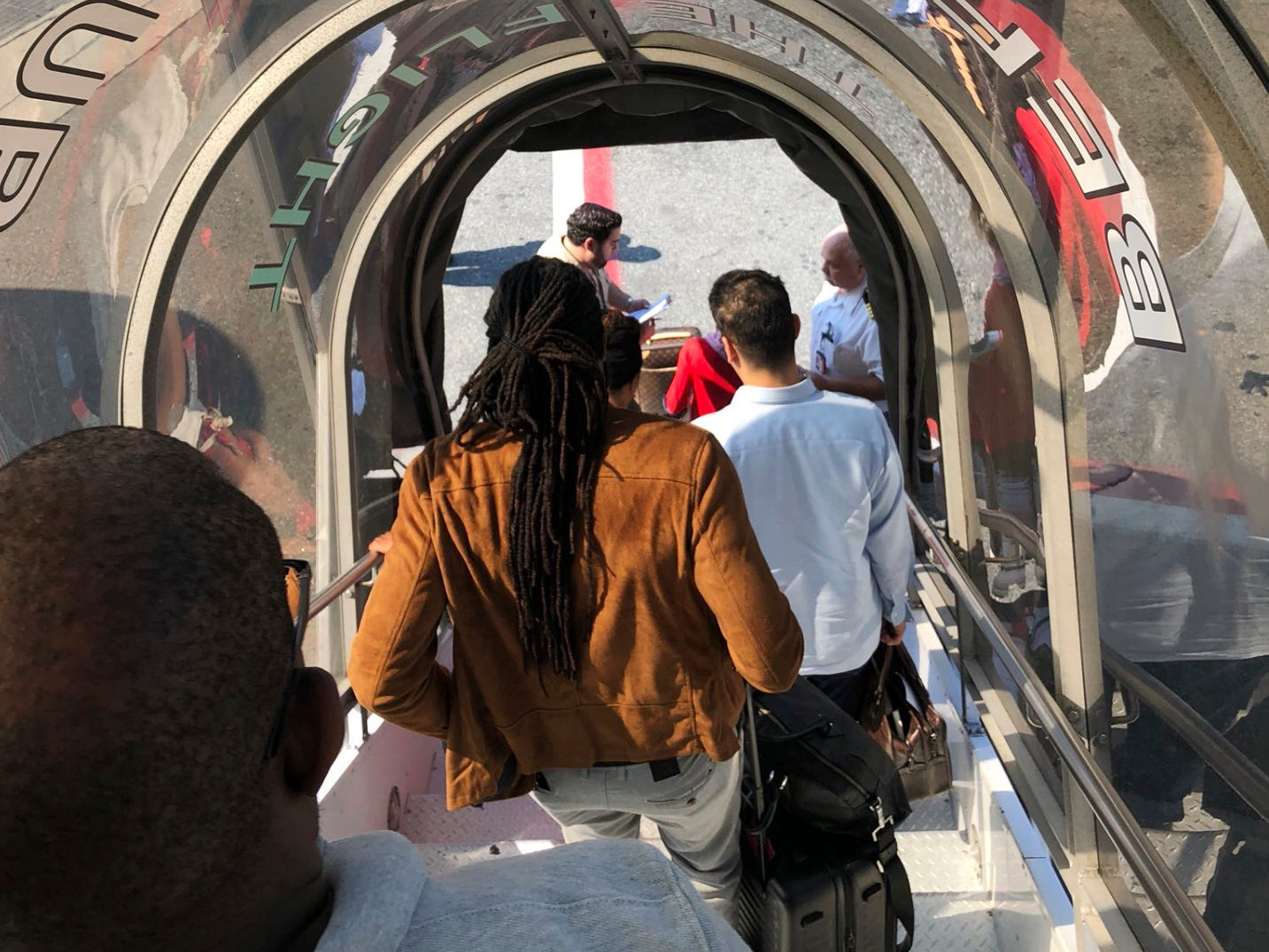 Passengers leave an Emirates airplane at New York's Kennedy Airport amid reports of ill passengers aboard a flight from Dubai on Wednesday, Sept. 5, 2018. (Larry Coben via AP) ORG XMIT: NYAG305