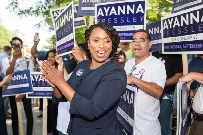 Boston City Councilwomen And House Democratic Candidate Ayanna Pressley applauds in front of her supporters during primary day on September 4, 2018 in Chelsea, Massachusetts. Pressley is campaigning for Boston's Seventh Congressional District against fellow Democrat Michael Capuano.