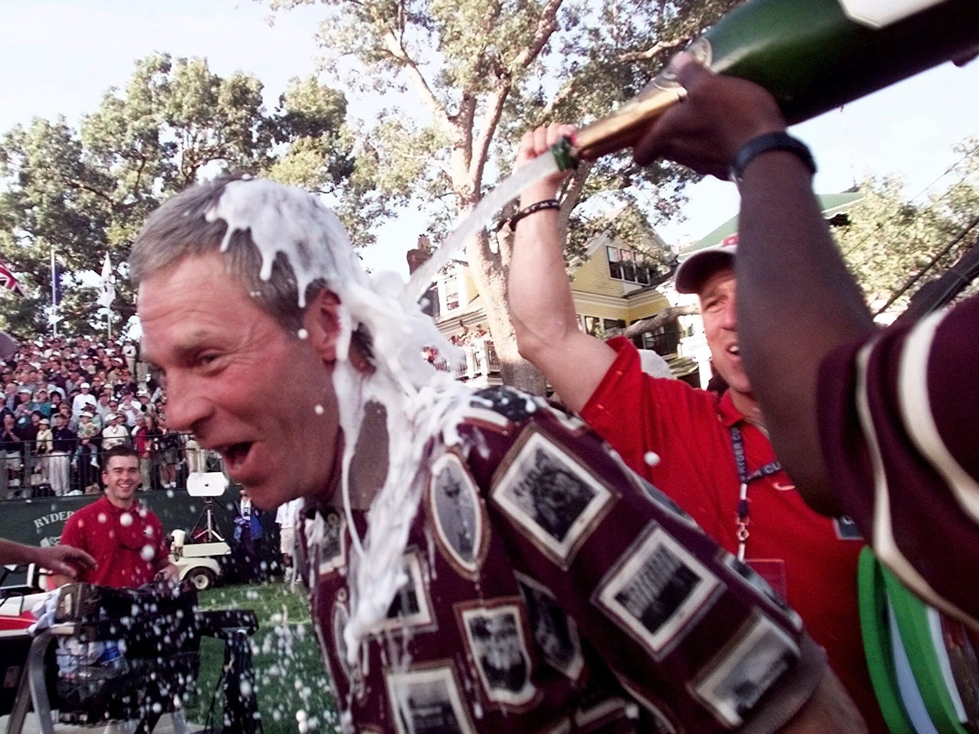 Team USA, 1999: Captain Ben Crenshaw is drenched in champagne after the U.S. defeated Europe 14.5-13.5.