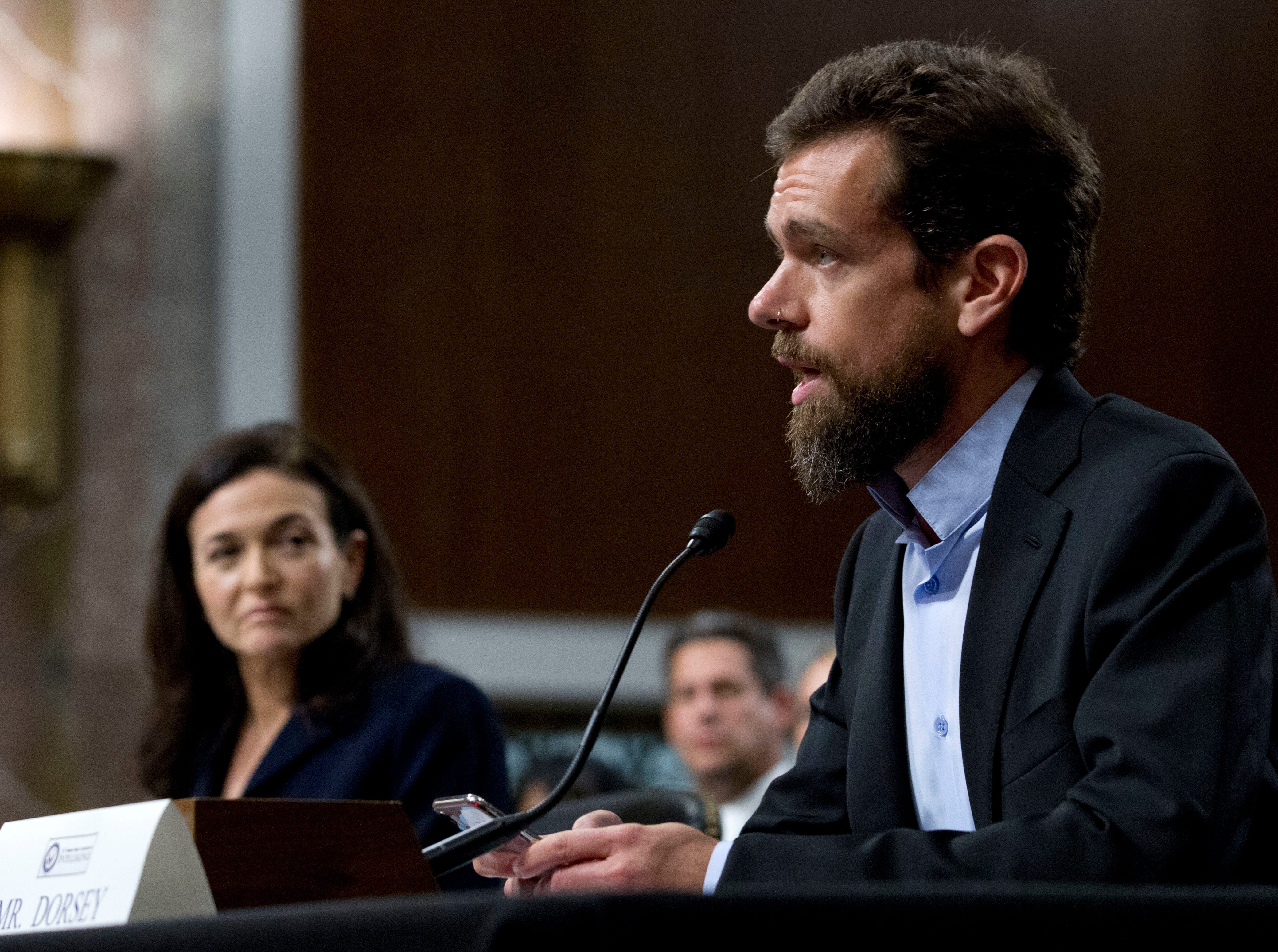 Twitter CEO Jack Dorsey, accompanied by Facebook COO Sheryl Sandberg, testify before the Senate Intelligence Committee hearing on 'Foreign Influence Operations and Their Use of Social Media Platforms' on Capitol Hill, Wednesday, Sept. 5, 2018, in Washington. (AP Photo/Jose Luis Magana) ORG XMIT: DCJL110
