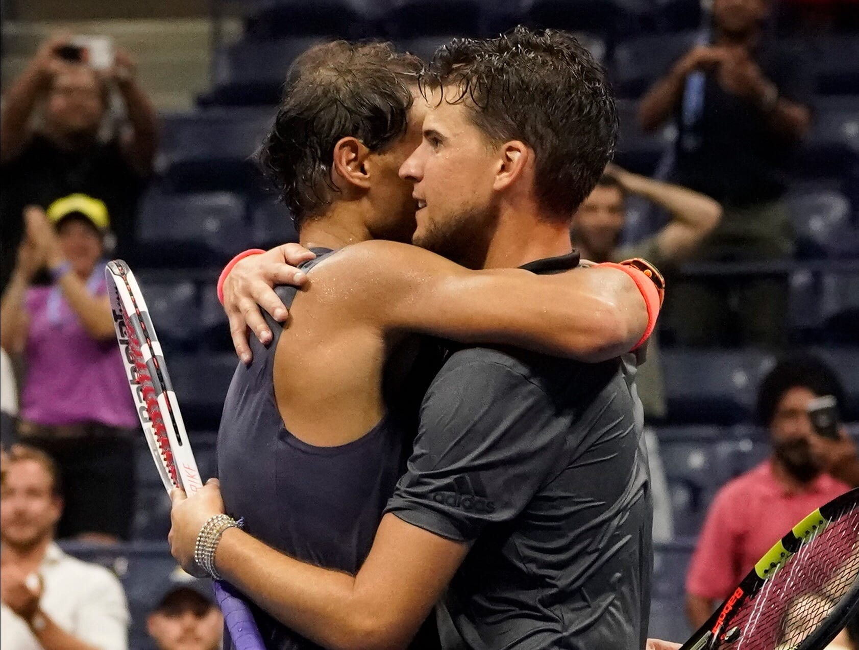Rafael Nadal and Dominic Thiem embrace after their quarterfinal match.