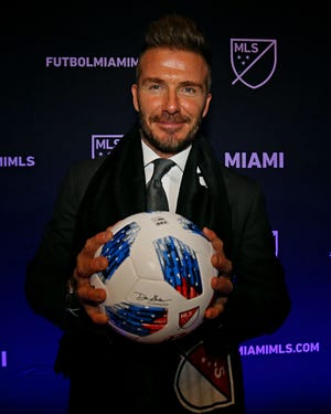 MLS team owner David Beckham holds an Adidas soccer ball during the Miami MLS expansion team announcement at the Adrienne Arsht Center.