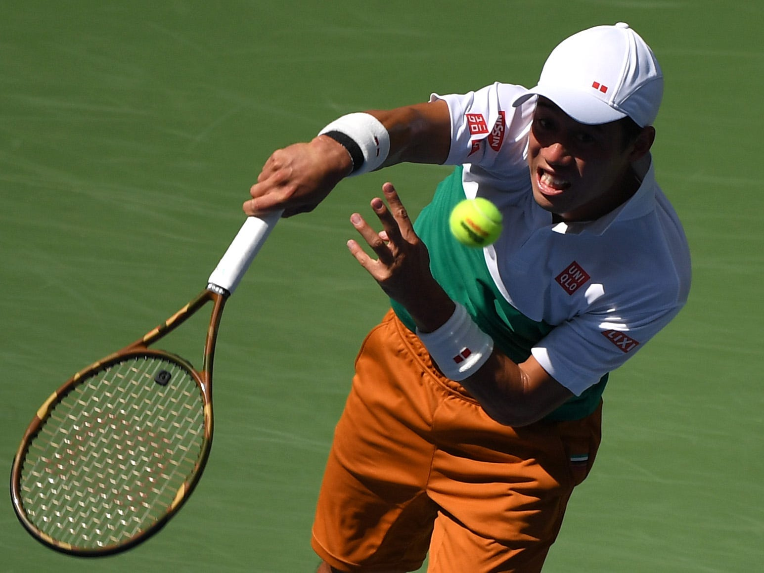 Japan's Kei Nishikori of Japan serves to Croatia's Marin Cilic during their quarterfinal match.