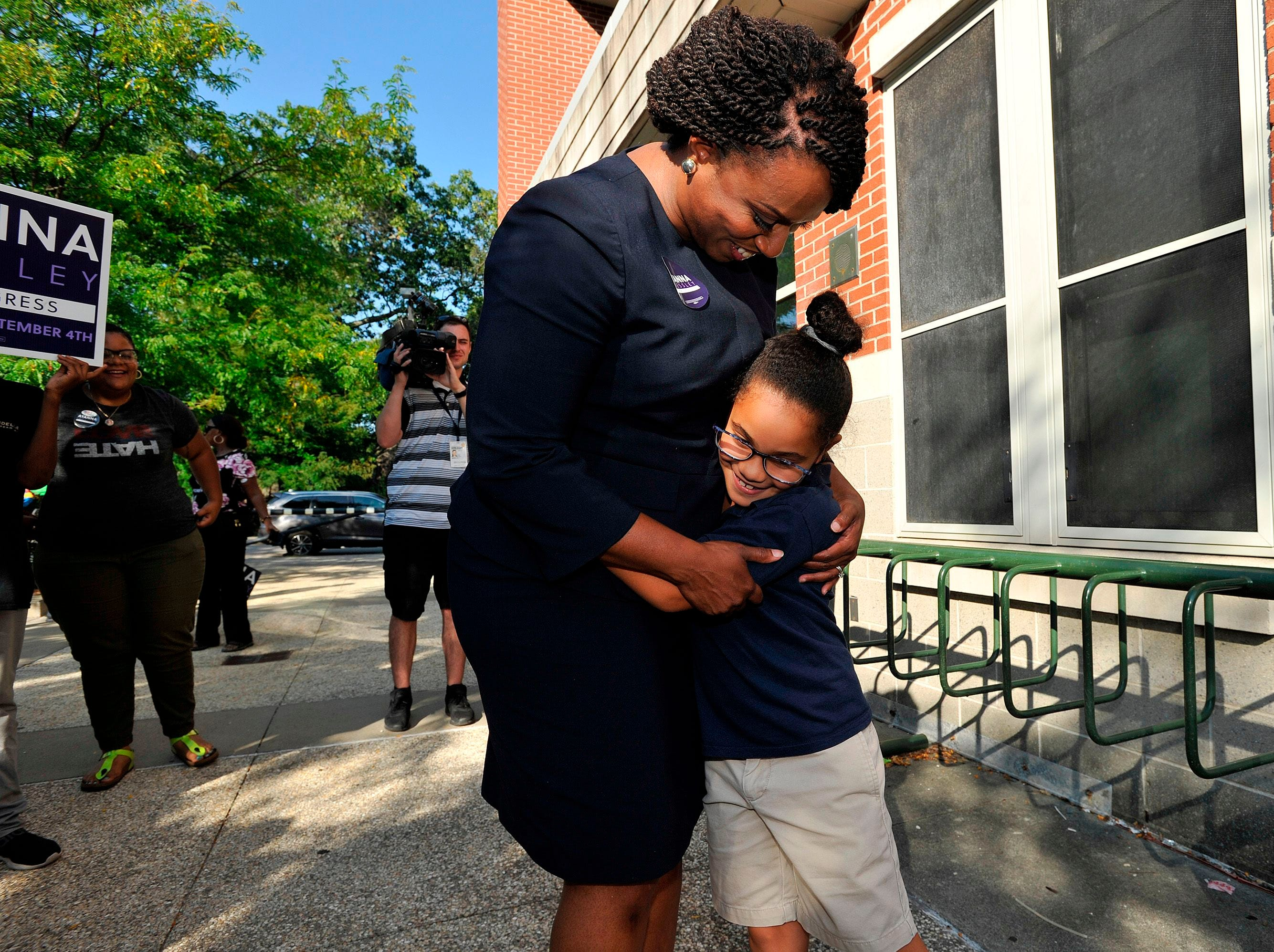 Ayanna Pressley, Democratic candidate for Congress,  gets a hug from a girl who said she voted for the candidate at the Mildred Middle School and Community Center in Boston, that served as a polling station for primary election on September 4, 2018.