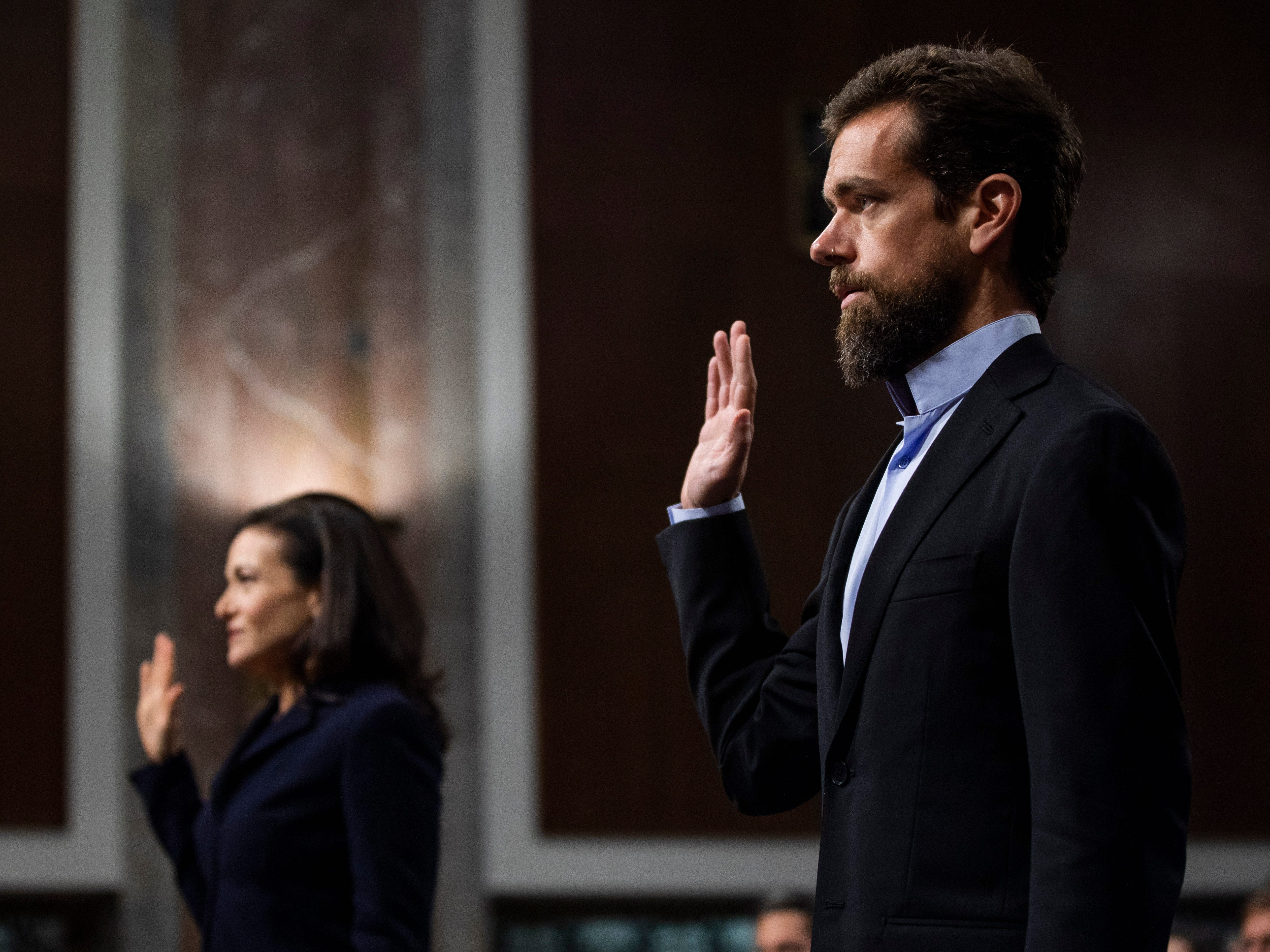CEO of Twitter Jack Dorsey (R) and COO of Facebook Sheryl Sandberg (L) are sworn-in before testifying at a Senate Intelligence Committee hearing on 'foreign influence operations and their use of social media platforms' in the Dirksen Senate Office Building in Washington, DC, USA, 05 September 2018. Lawmakers are expected to ask the top executives what measures they are implementing to protect their online content from Russian propaganda and political censorship. CEO of Alphabet (Google) Larry Page was invited to testify but did not show.