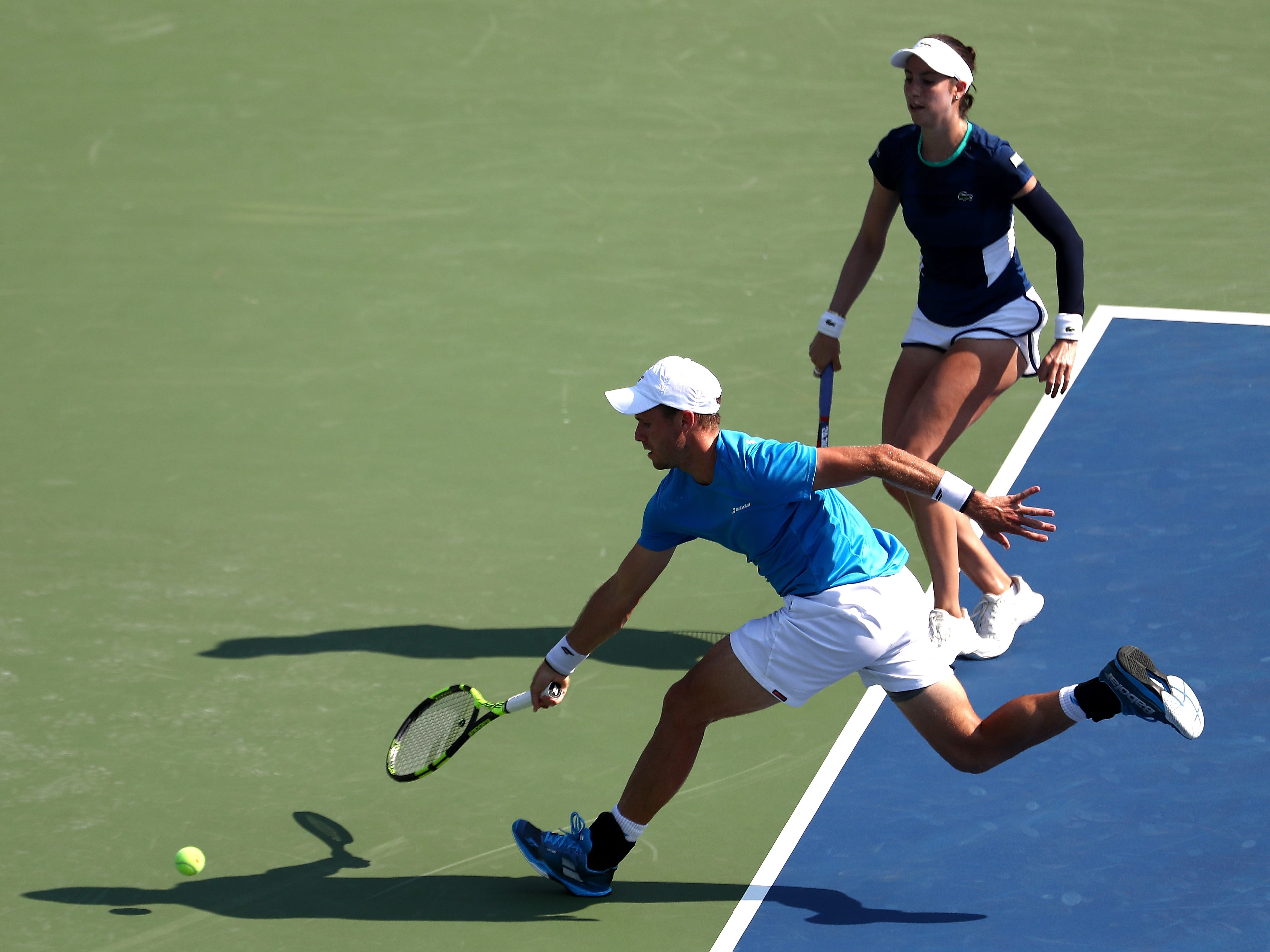 Americans Christian Harrison, left, and Christina McHale chase down a shot during the mixed doubles semifnal match against Jamie Murray and Bethanie Mattek-Sands.