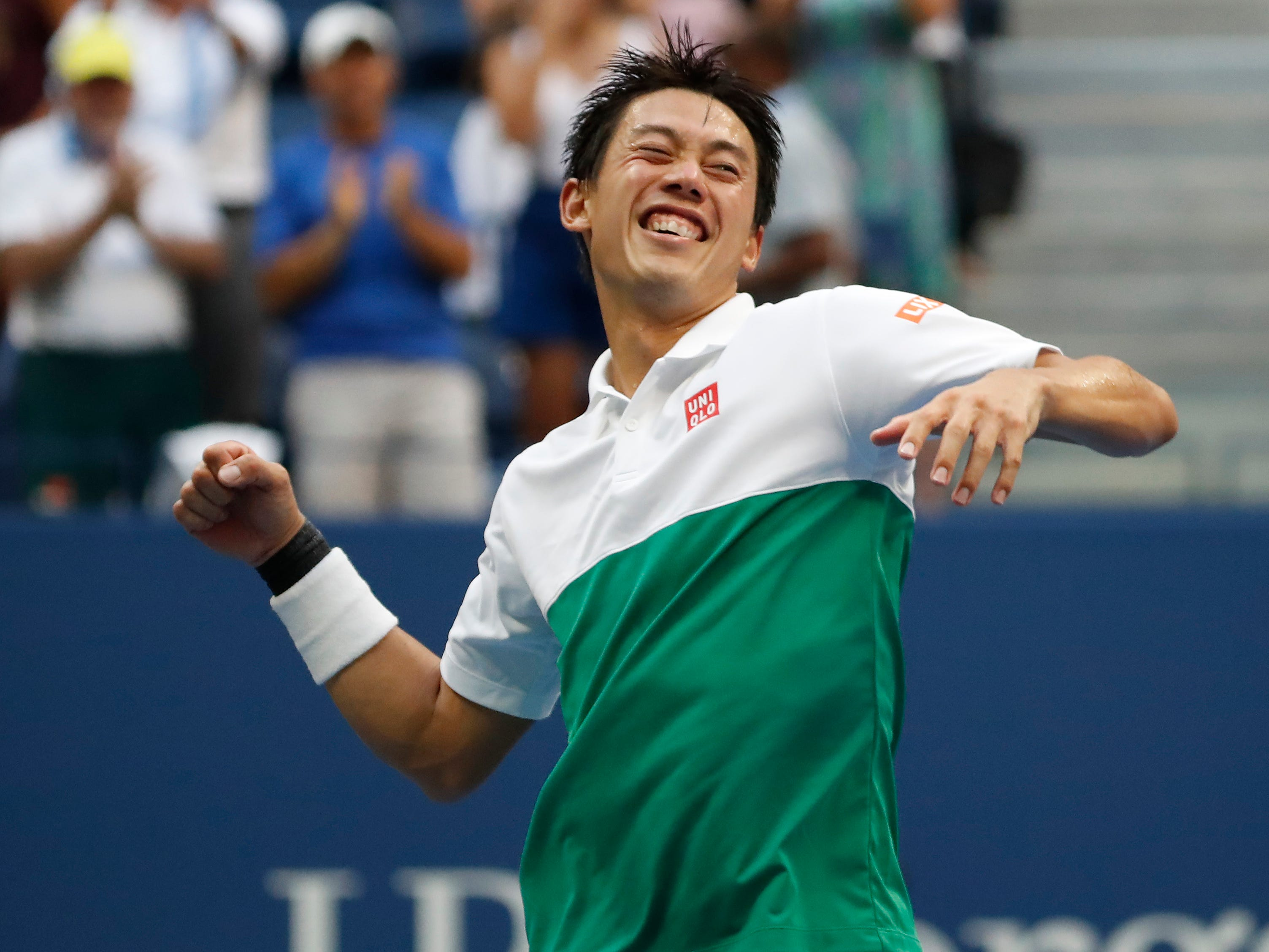 Kei Nishikori, the 21st seed, celebrates after outlasting No. 7 seed Marin Cilic 2-6, 6-4, 7-6 (7-5), 4-6, 6-4 in the quarterfinals.