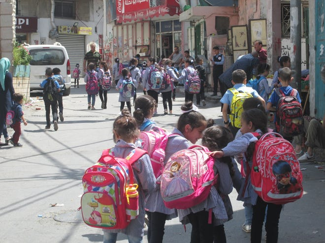 Children who live in the Dheisheh refugee camp attend a school run by United Nations Refugee and Works Agency. Palestinians fear that an end to U.S. funding of UNRWA schools, clinics and programs will make the already difficult lives of refugees even more difficult.