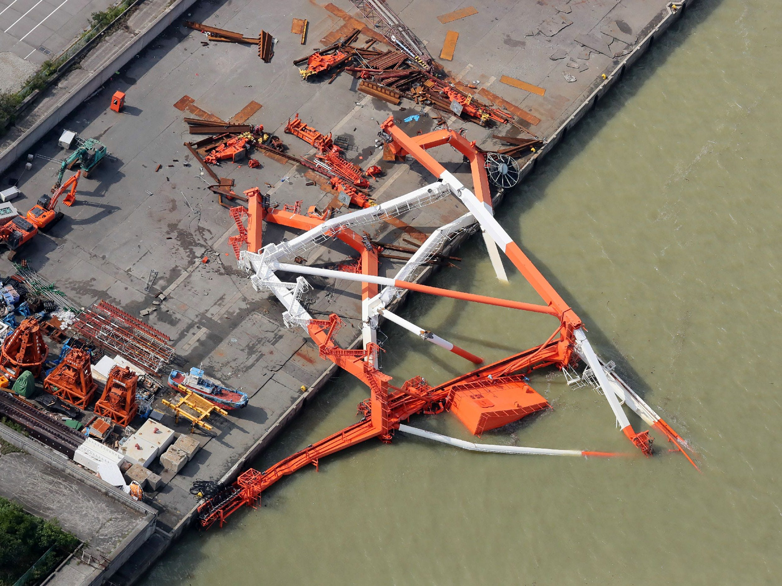 A crane is toppled due to strong winds in Nishinomiya city, Hyogo prefecture on Sept. 5, 2018, after typhoon Jebi hit the west coast of Japan.