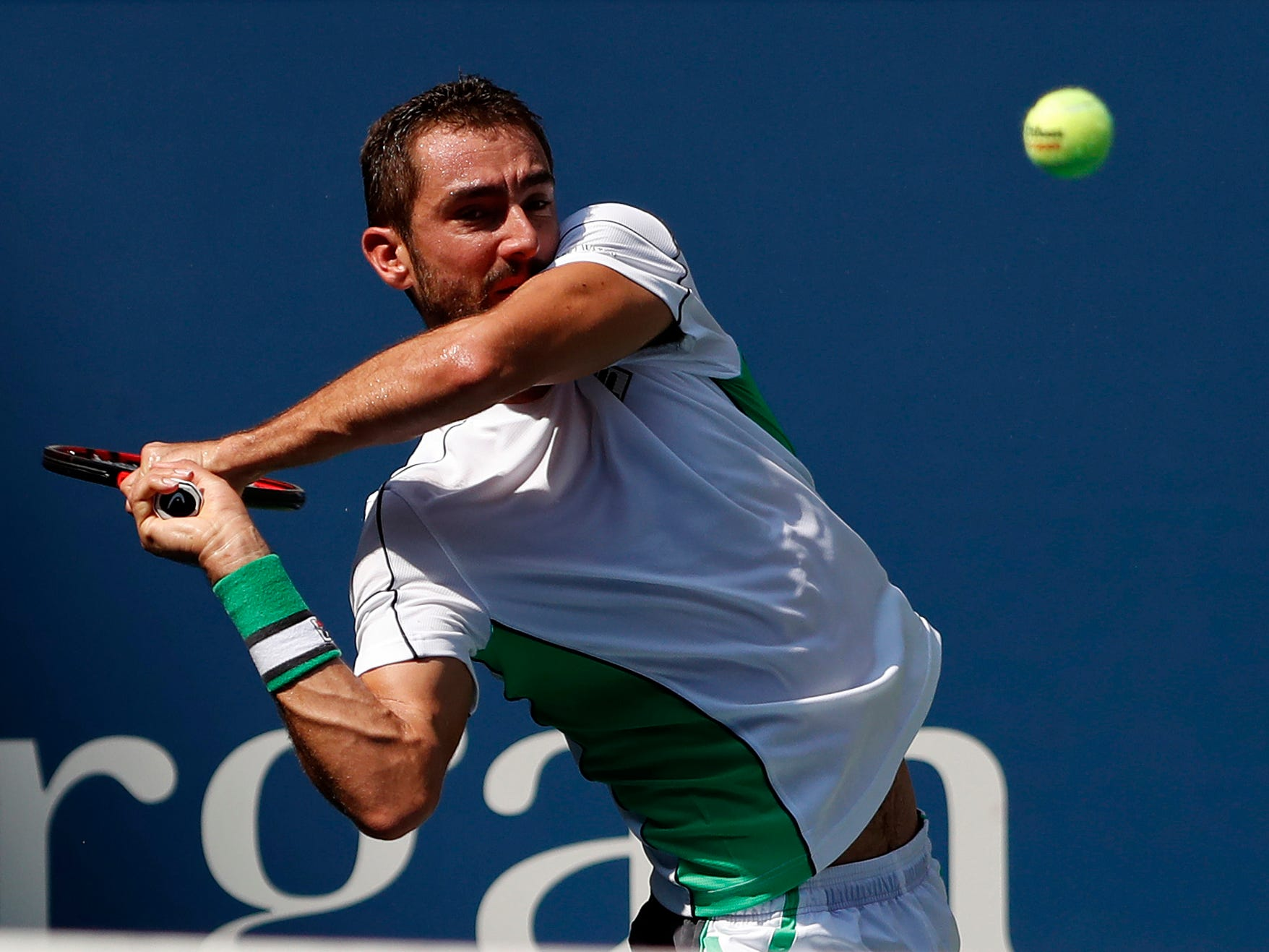 Croatia's Marin Cilic of Croatia hits a backhand against Japan's Kei Nishikori during their quarterfinal match.