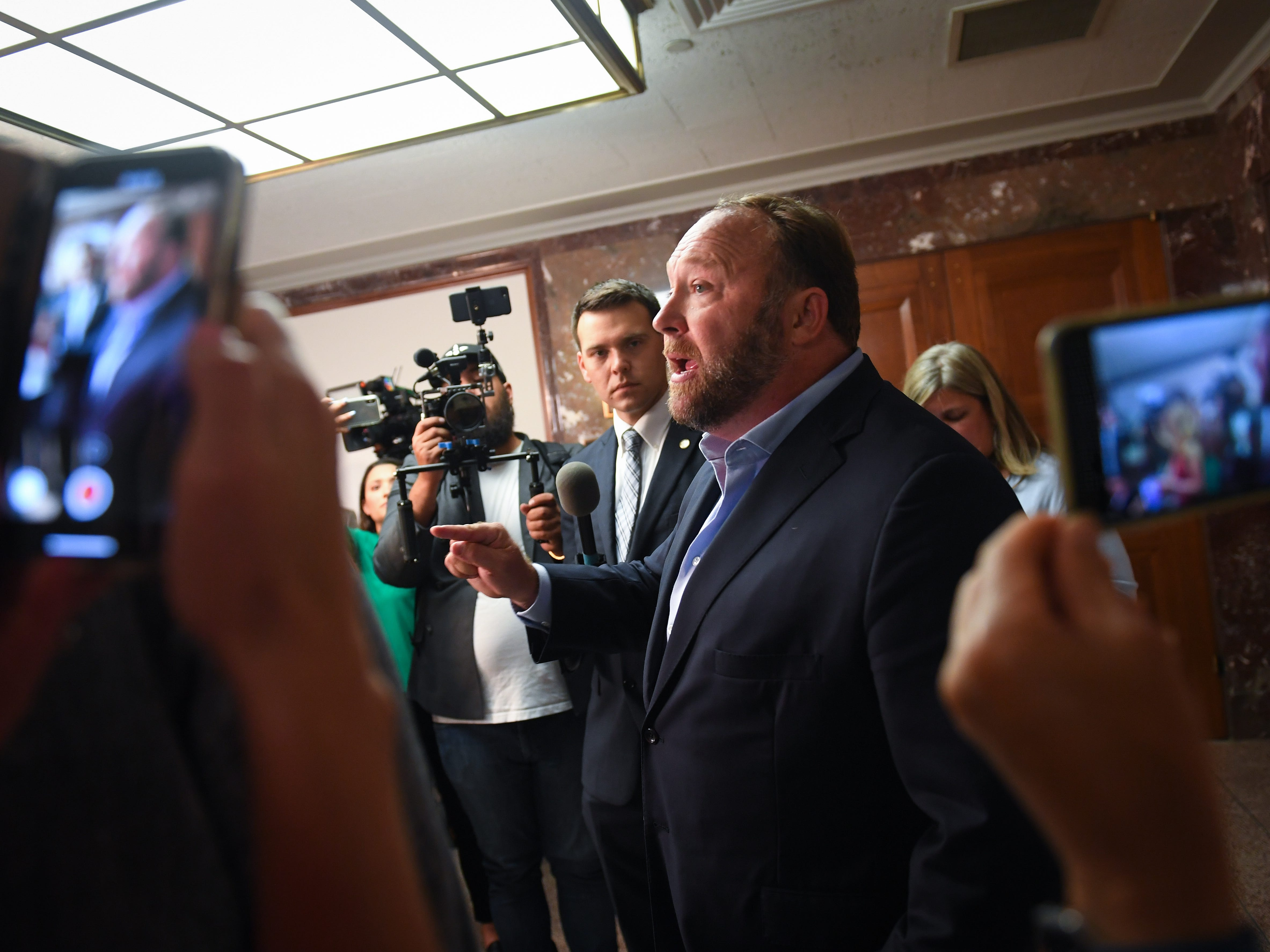 9/5/18 9:48:18 AM -- Washington, DC, U.S.A  -- Radio show host Alex Jones passionately speaking to the media just outside of the committee room doors where Sheryl Sandberg, chief operating officer of Facebook Inc., and Jack Dorsey, chief executive officer of Twitter Inc., testify before the Senate Select Committee on Intelligence during a hearing on Foreign Influence Operations' Use of Social Media Platforms on Sept. 5, 2018 in Washington.  --    Photo by Jack Gruber, USA TODAY Staff ORG XMIT:  JG 137441 Social Media Hea 9/5/ (Via OlyDrop)