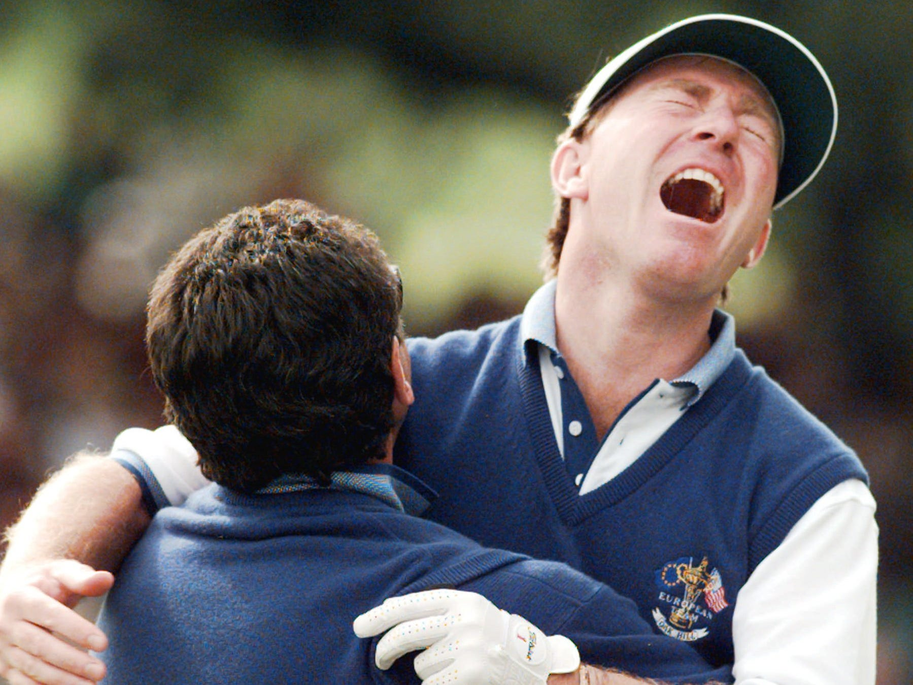 Team Europe, 1995: Philip Walton is hugged by captain Bernard Gallacher after Walton clinched overall victory for Europe 14.5-13.5.