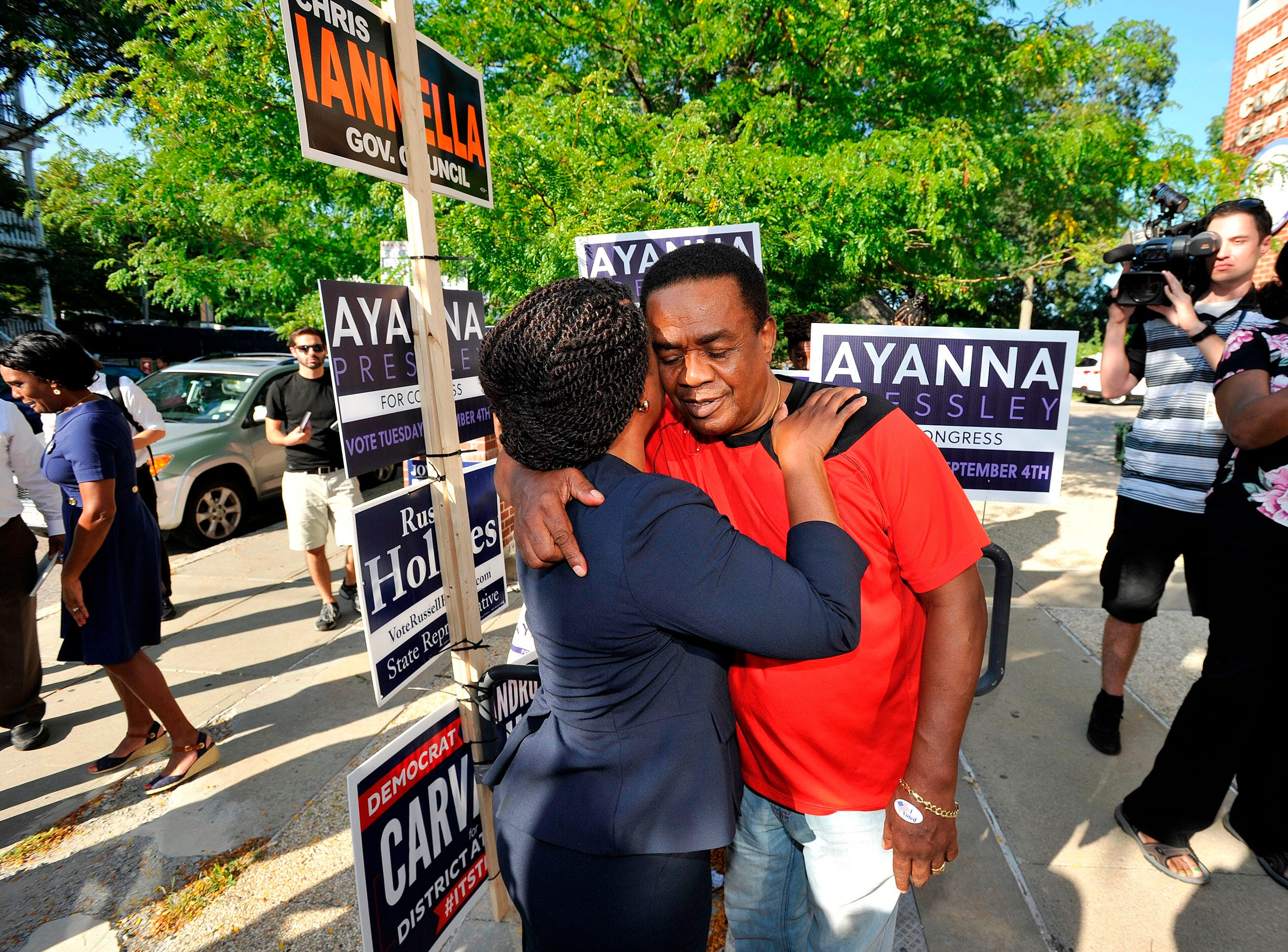 Ayanna Pressley, Democratic candidate for Congress,  embraces a supporter at the Mildred Middle School and Community Center in Boston, that served as a polling station for primary election on September 4, 2018.