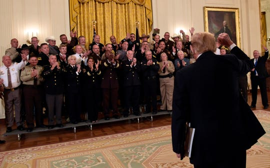 President Donald Trump walks out of the East Room of the White House in Washington, Wednesday, Sept. 5, 2018, following an event with sheriffs. (AP Photo/Susan Walsh) ORG XMIT: DCSW115