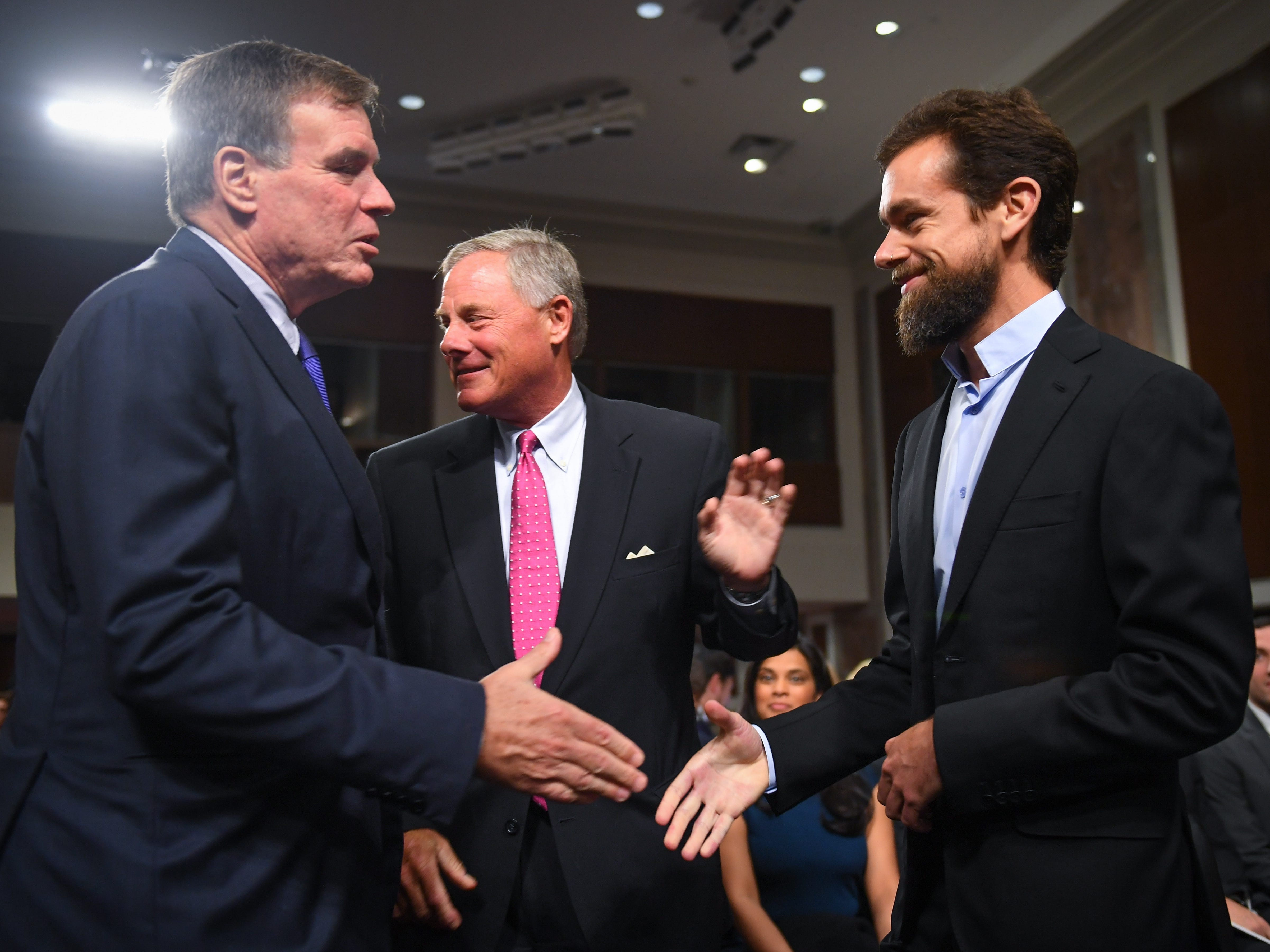 9/5/18 9:32:10 AM -- Washington, DC, U.S.A  -- Jack Dorsey, chief executive officer of Twitter Inc., arrives and meets Senators Mark Warner, left, and Richard Burr before he would testify before the Senate Select Committee on Intelligence during a hearing on Foreign Influence Operations' Use of Social Media Platforms on Sept. 5, 2018 in Washington.  --    Photo by Jack Gruber, USA TODAY Staff ORG XMIT:  JG 137441 Social Media Hea 9/5/ (Via OlyDrop)