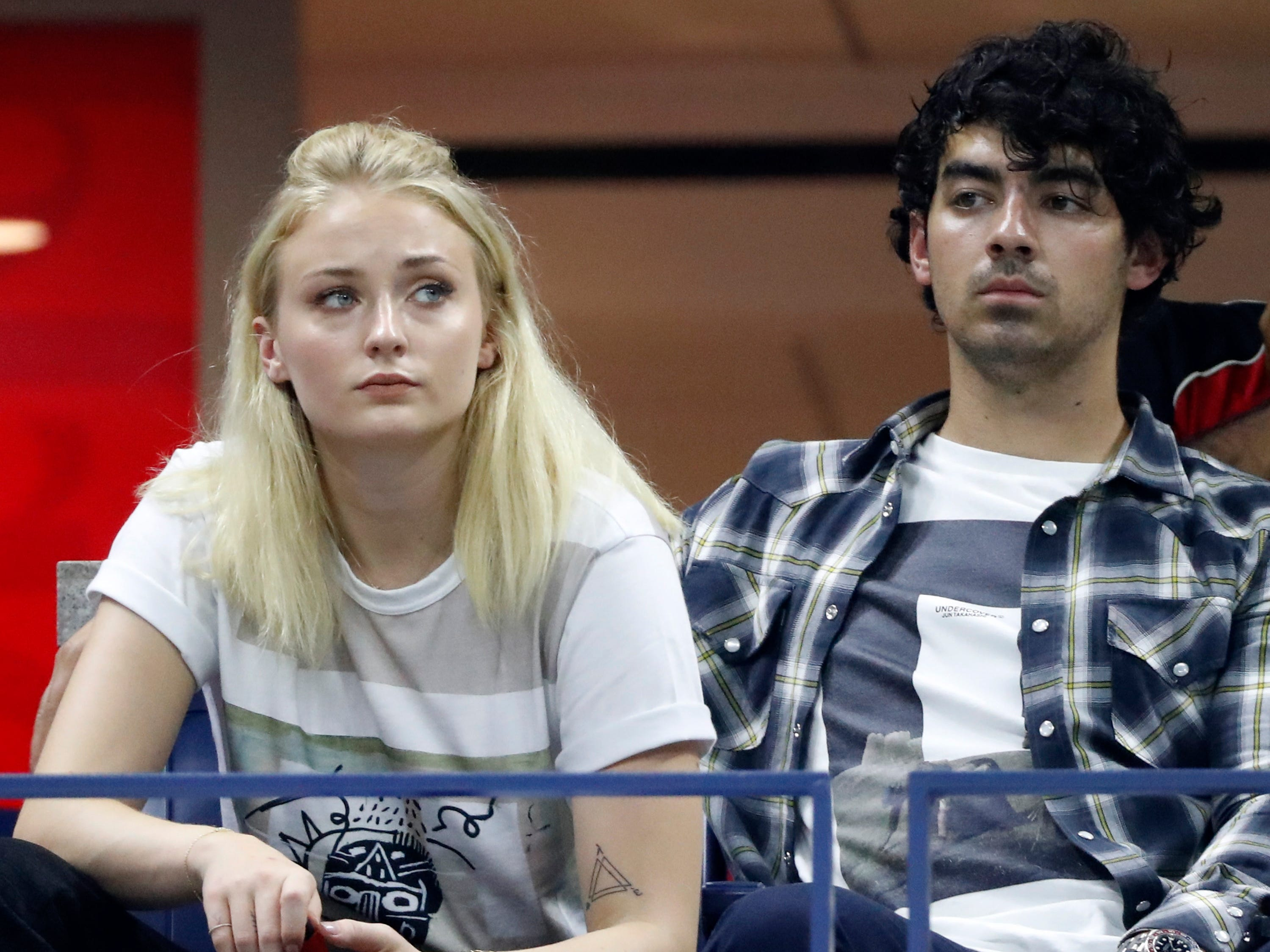 British actress Sophie Turner and singer Joe Jonas watch the Dominic Thiem vs. Rafael Nadal quarterfinal match.