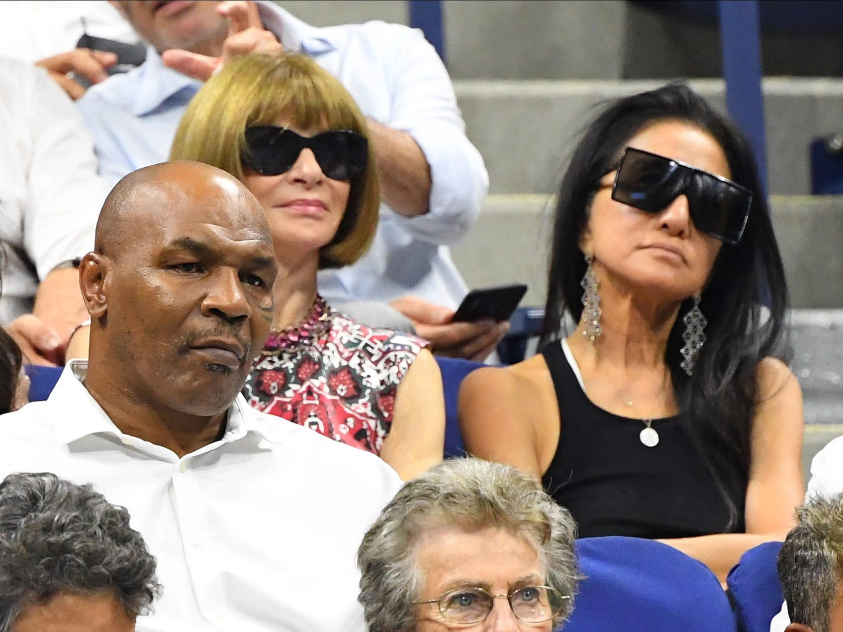 Mike Tyson (left), Anna Wintour (middle) and Vera Wang (right) watch the matches on Day 1 of the US Open.