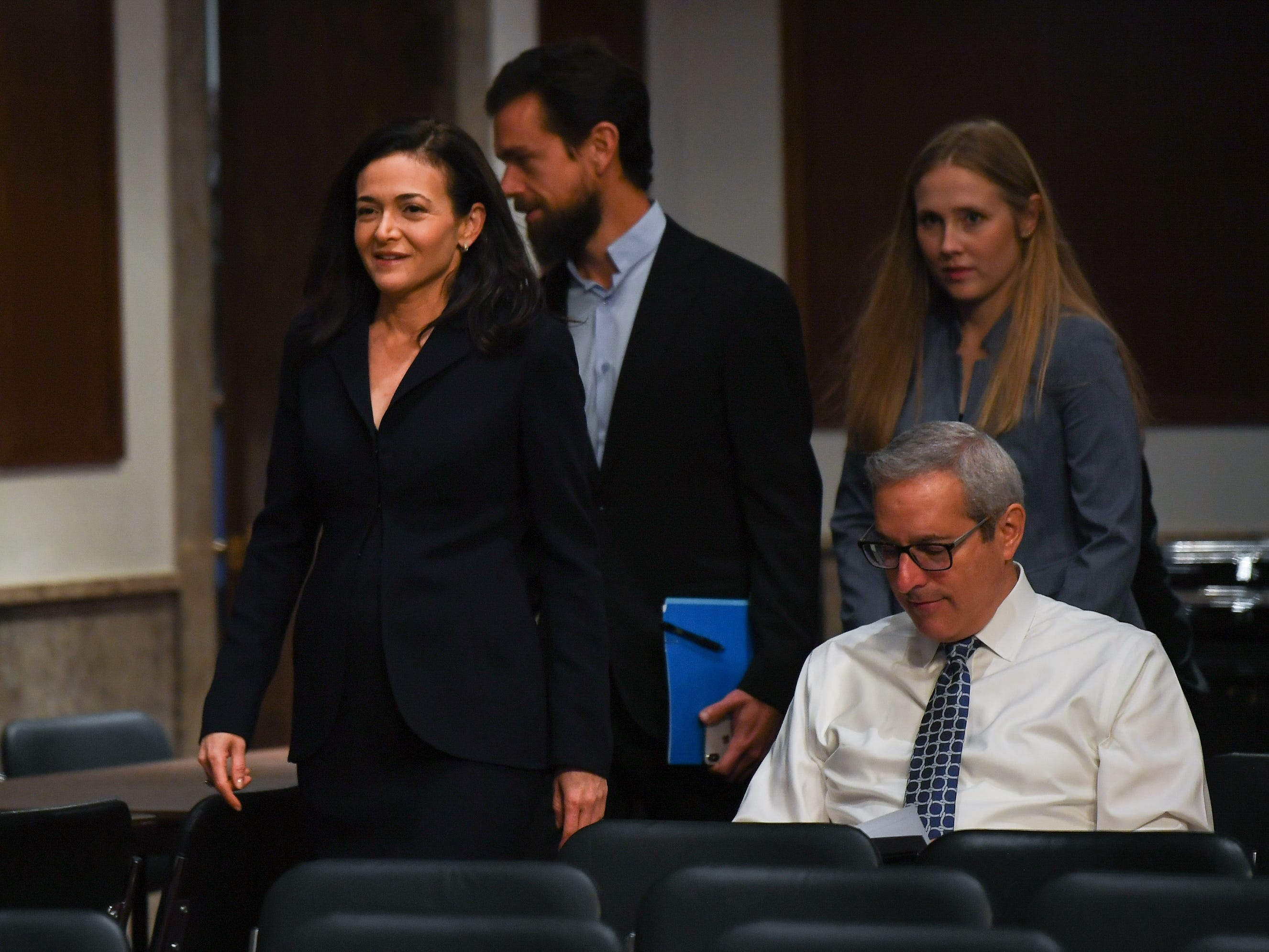 9/5/18 8:41:04 AM -- Washington, DC, U.S.A  -- Sheryl Sandberg, chief operating officer of Facebook Inc., left, and Jack Dorsey, chief executive officer of Twitter Inc., center, arrive to a near empty room to testify before the Senate Select Committee on Intelligence during a hearing on Foreign Influence Operations' Use of Social Media Platforms on Sept. 5, 2018 in Washington.  --    Photo by Jack Gruber, USA TODAY Staff ORG XMIT:  JG 137441 Social Media Hea 9/5/ (Via OlyDrop)
