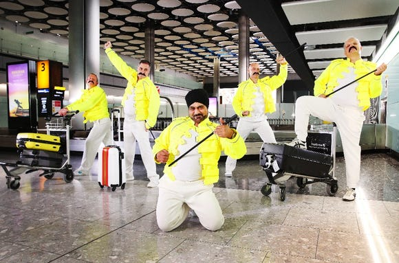 British Airways and Heathrow baggage handlers pay tribute to Freddie Mercury for the rock legend's Sept. 5 birthday celebrations at Heathrow T5.