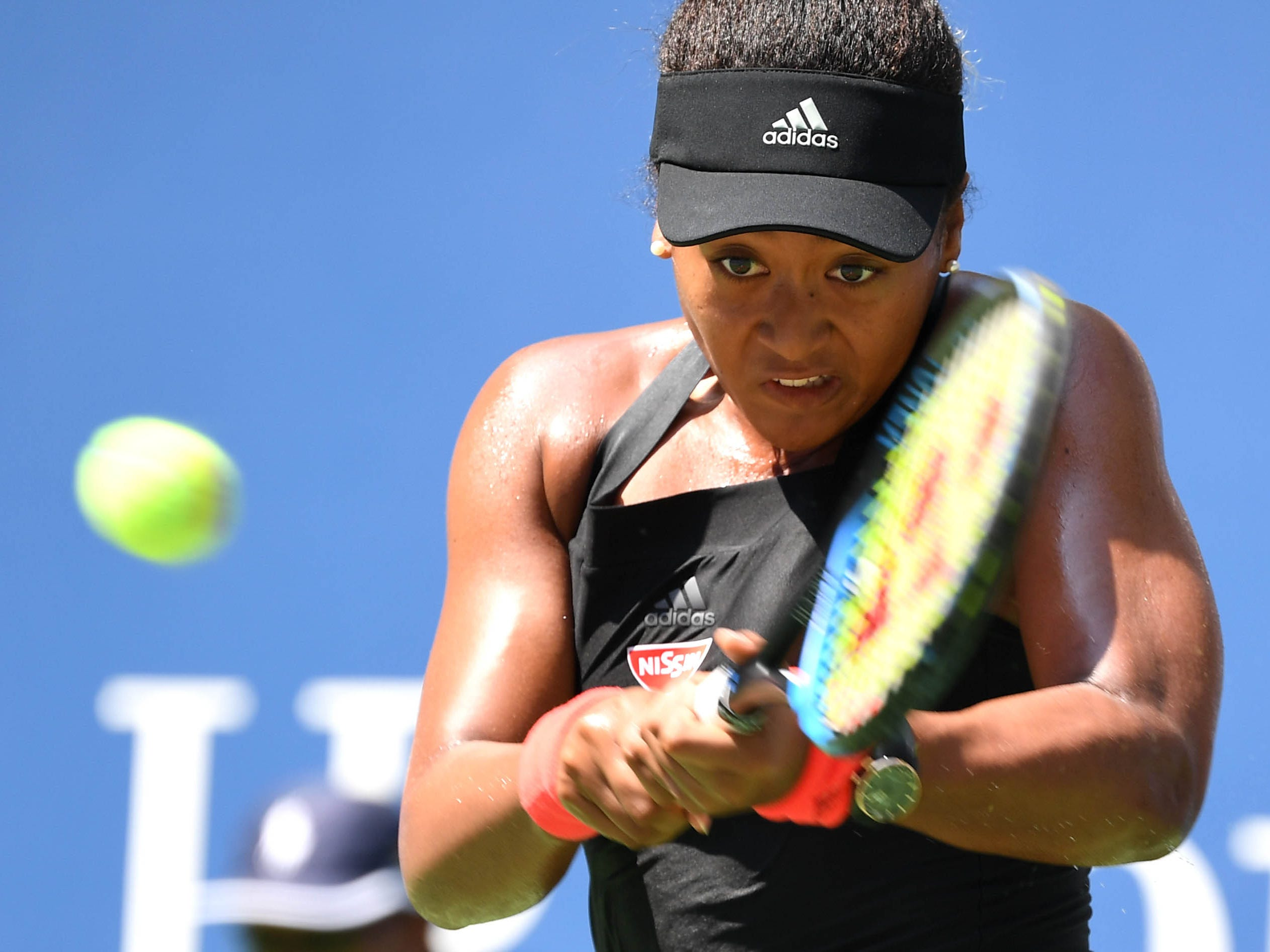 Naomi Osaka, the 20th seed, strokes a backhand to Lesia Tsurenko during her 6-1, 6-1 quarterfinal win.