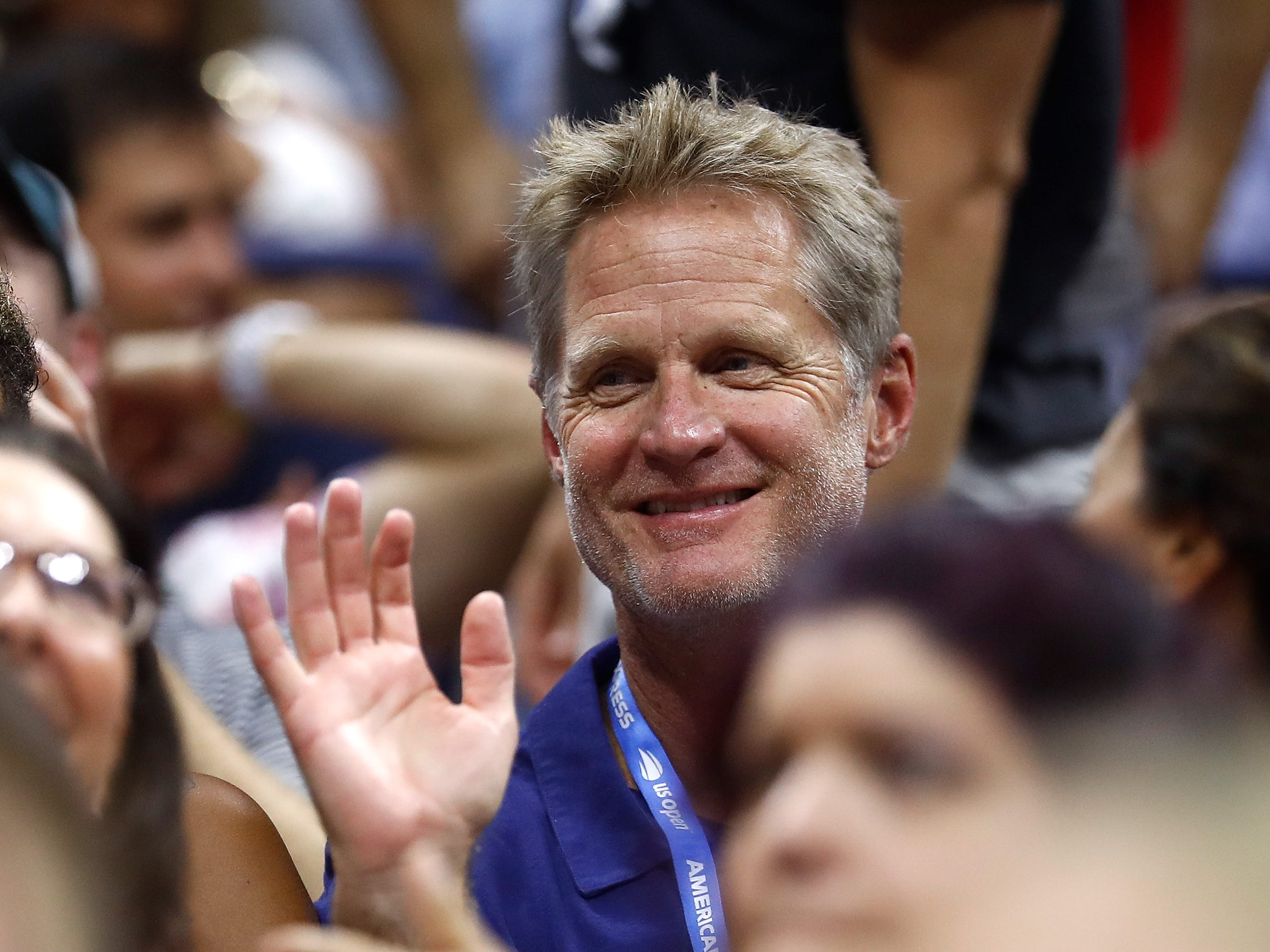 Warriors coach Steve Kerr watches the fourth-round match between John Millman and Roger Federer.