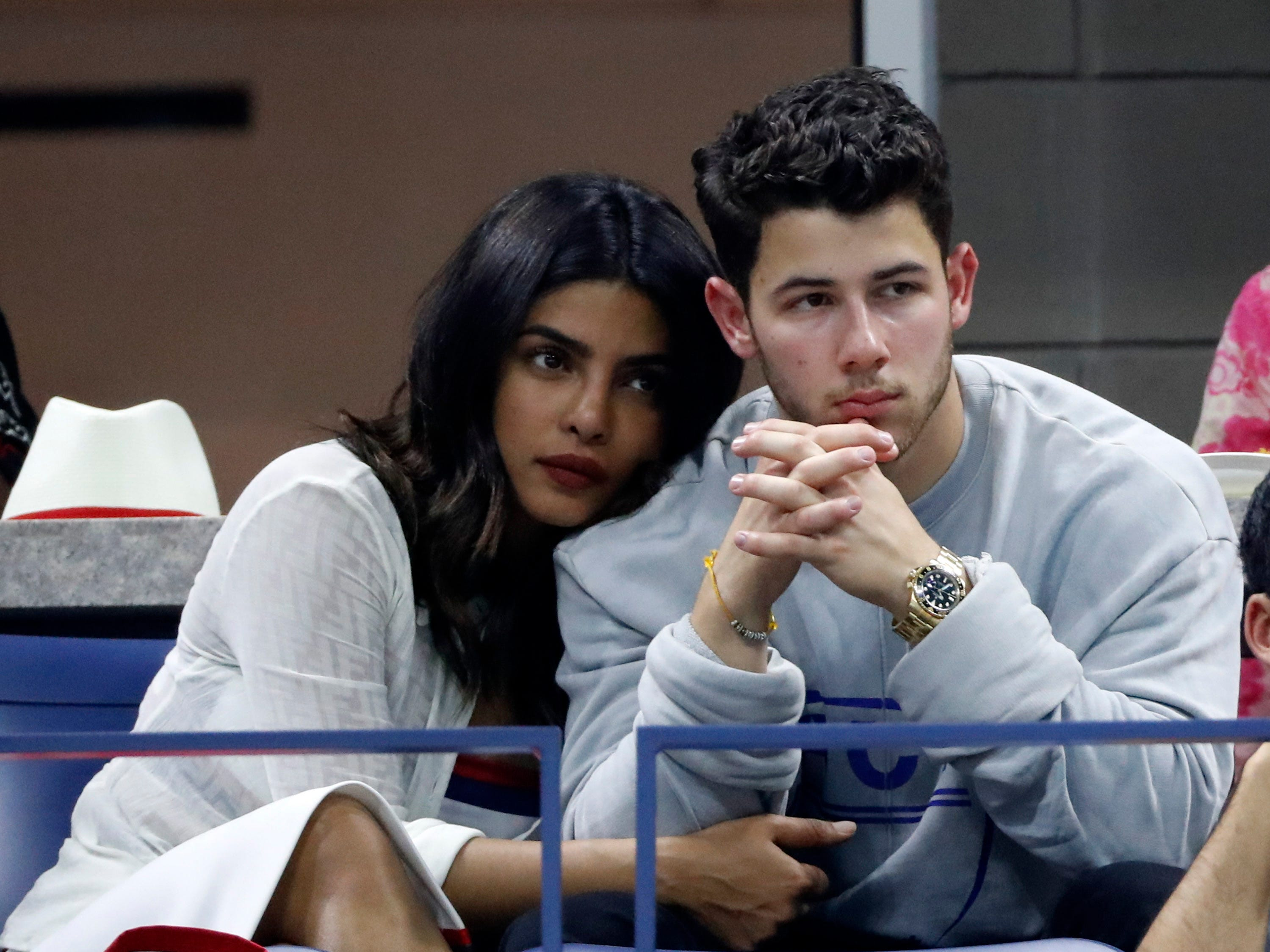 Indian actress Priyanka Chopra and her fiance Nick Jonas watch the Dominic Thiem vs. Rafael Nadal quarterfinal match.