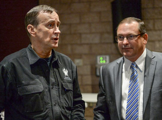 Dave Grossman, left, director of the Illinois-based Killology Research Group, talks with Autech LLC President Rockey Burgess, during a school-safety training seminar at the Civic Center of Anderson on Thursday. Burgess said his company paid for the event featuring Grossman to help promote school safety.