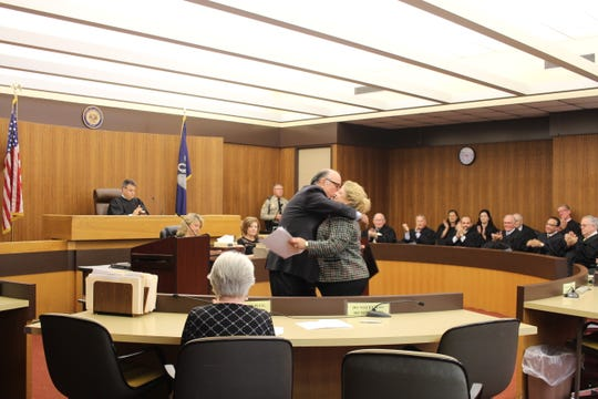 Attorney Harold Murry (left) hugs Dona Renegar, who was the guest speaker Wednesday at the 2018 Opening of Court ceremony at the Rapides Parish Courthouse. Murry hired Renegar years ago, taking the law school graduate from a job as a French teacher in Jefferson Davis Parish.