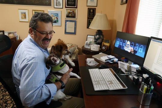 Steven W. Wertheim, president of SonMax Consultants Inc., works in his home office with his dogs, Ginger and Cocoa, in Marlboro, NJ Thursday September 6, 2018.