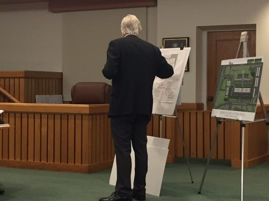Engineer Kenneth Schlatmann describes changes to a development planned for Cox Cro road and Route 9.