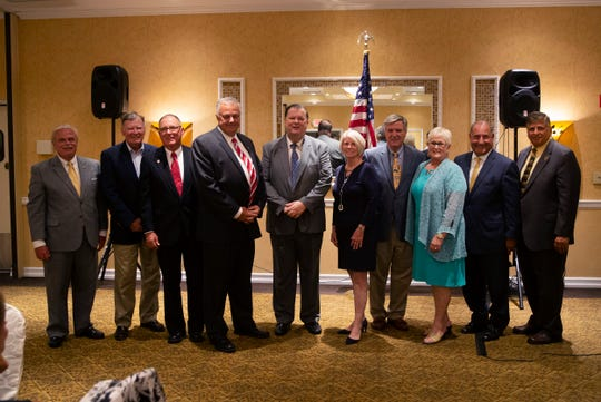 Key Ocean County Republicans pose for a picture at end of special convention where Lacey Committeeman Gary Quinn (fourth from left) was chosen to run for Ocean County Freeholder.