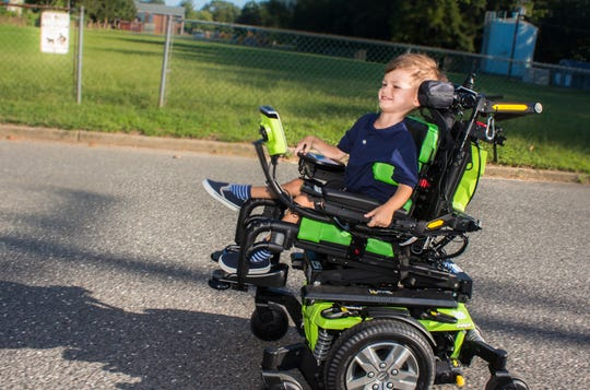 Harry Smith with his new electric wheelchair
