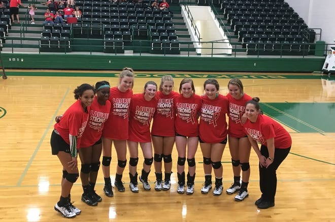 Varsity members of the Breckenridge volleyball team join head coach Leslie Anaya, right, for a pose in their #LaurenStrong T-shirts.