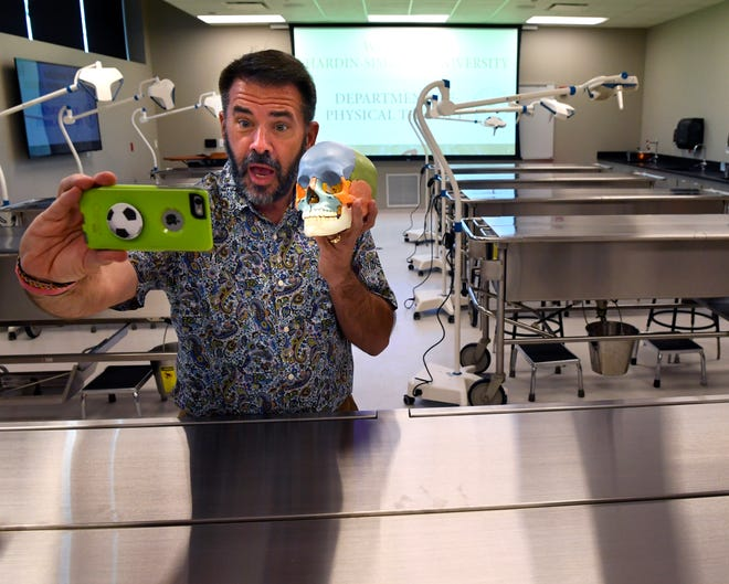 Abilene City Councilman Kyle McAlister takes a selfie with an artificial, color-coded skull in the Anatomy Lab at the new Hardin-Simmons University physical therapy building Thursday. The building was previously AbLabs, or the Abilene Life Sciences Accelerator, at 1325 Pine St. which was built in 2010 but failed to bring high-paying biomedical jobs to Abilene. HSU bought the building in October.