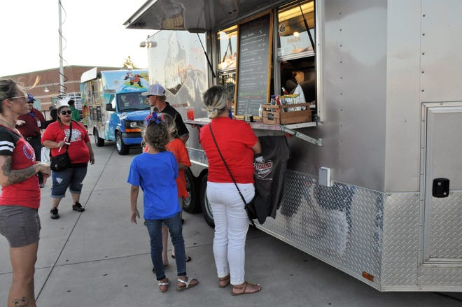 The Toasted Traveler food trailer and Kona Ice truck serve customers at Shotwell Stadium on  Aug. 31.