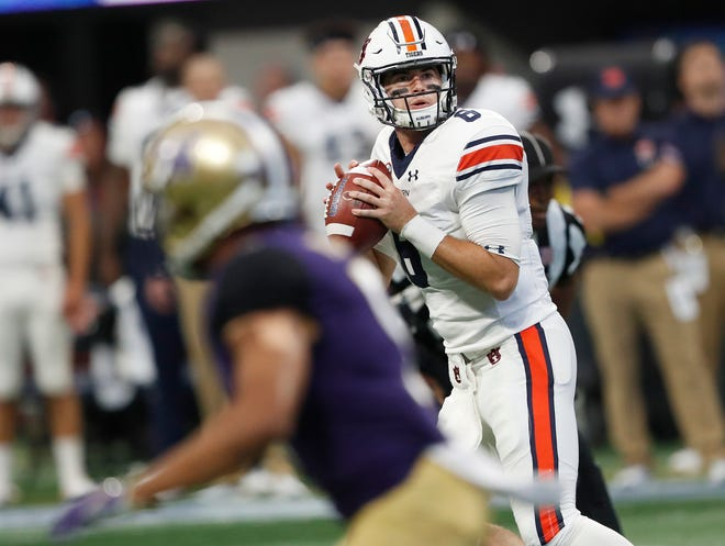 Auburn quarterback Jarrett Stidham (8) throws a pass in the first half against Washington on Saturday, Sept. 1, 2018, in Atlanta.