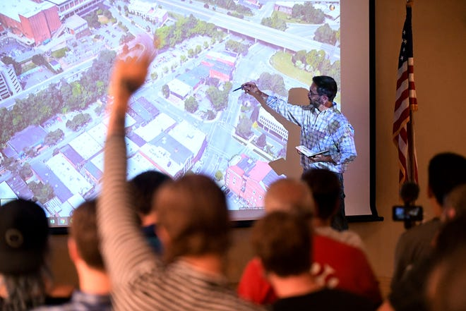 Chris Day, a civil engineer, discusses the proposed building at 95 Broadway St. during a public meeting at Pack Memorial Library Sept. 6, 2018. Public comment was heated during the meeting, with those in attendance opposing the building that would include hotel rooms and condos.