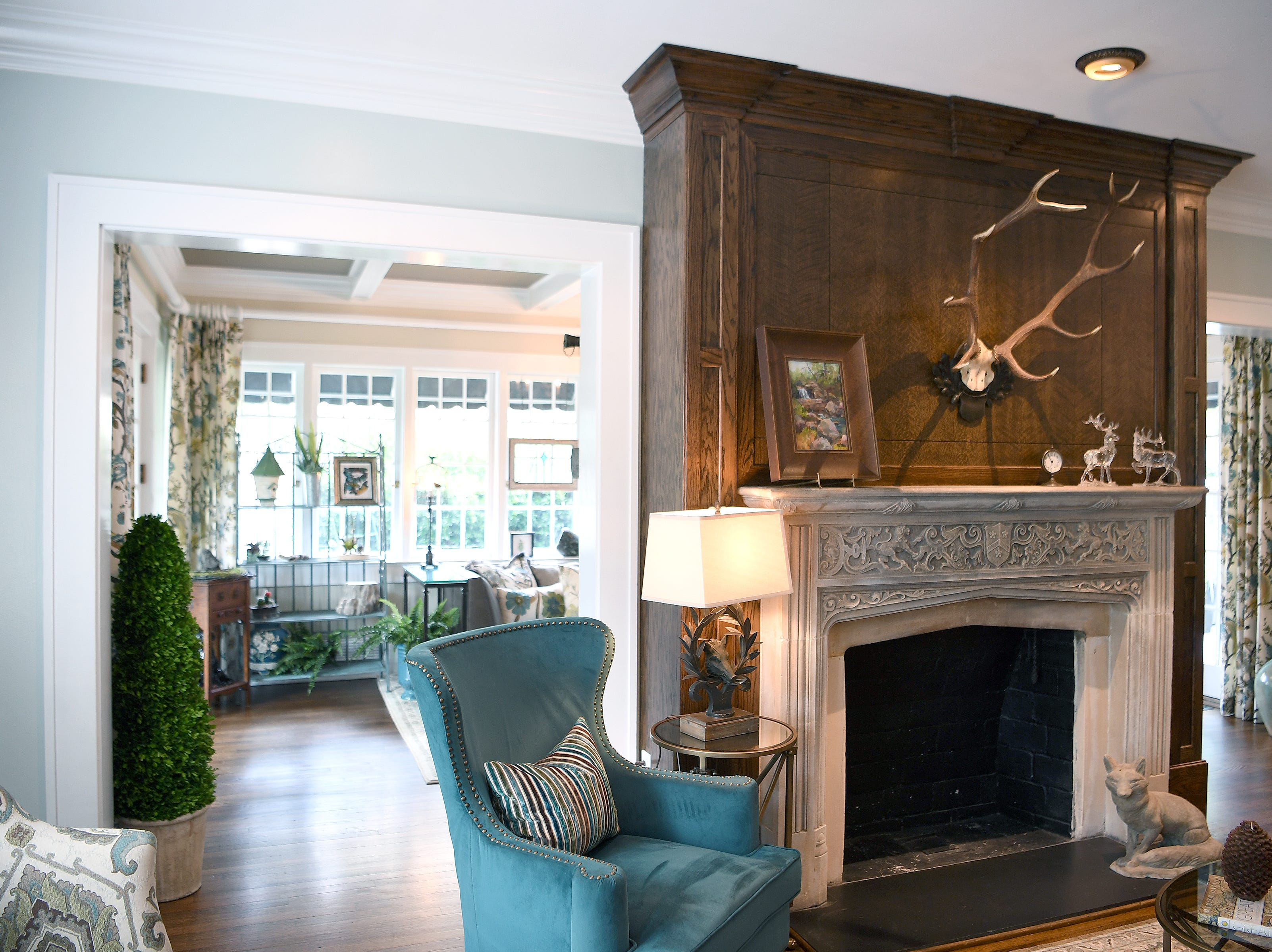 The limestone carved mantle and the restored oak floors are original to the 1925 construction of the Bryant family's North Asheville home.