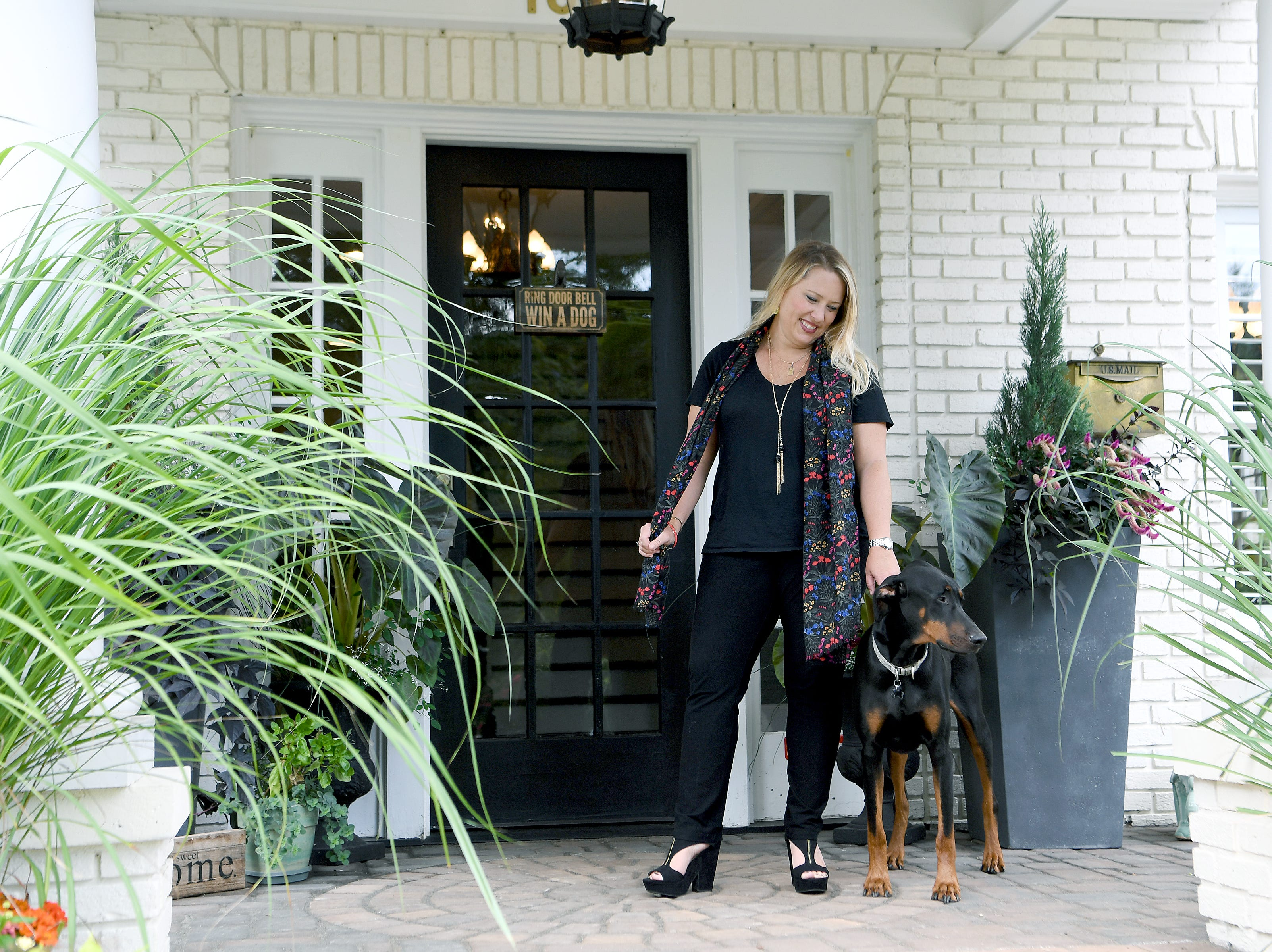 Moriah Bryant with one of her dogs, Duncan, on the porch of her family's North Asheville home on Tuesday, Aug. 21, 2018. The house, which was built in 1925, features four bedrooms, a kids playroom, two full bathrooms and a half bath.