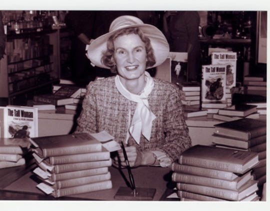 Wilma Dykeman with copies of one of her books.