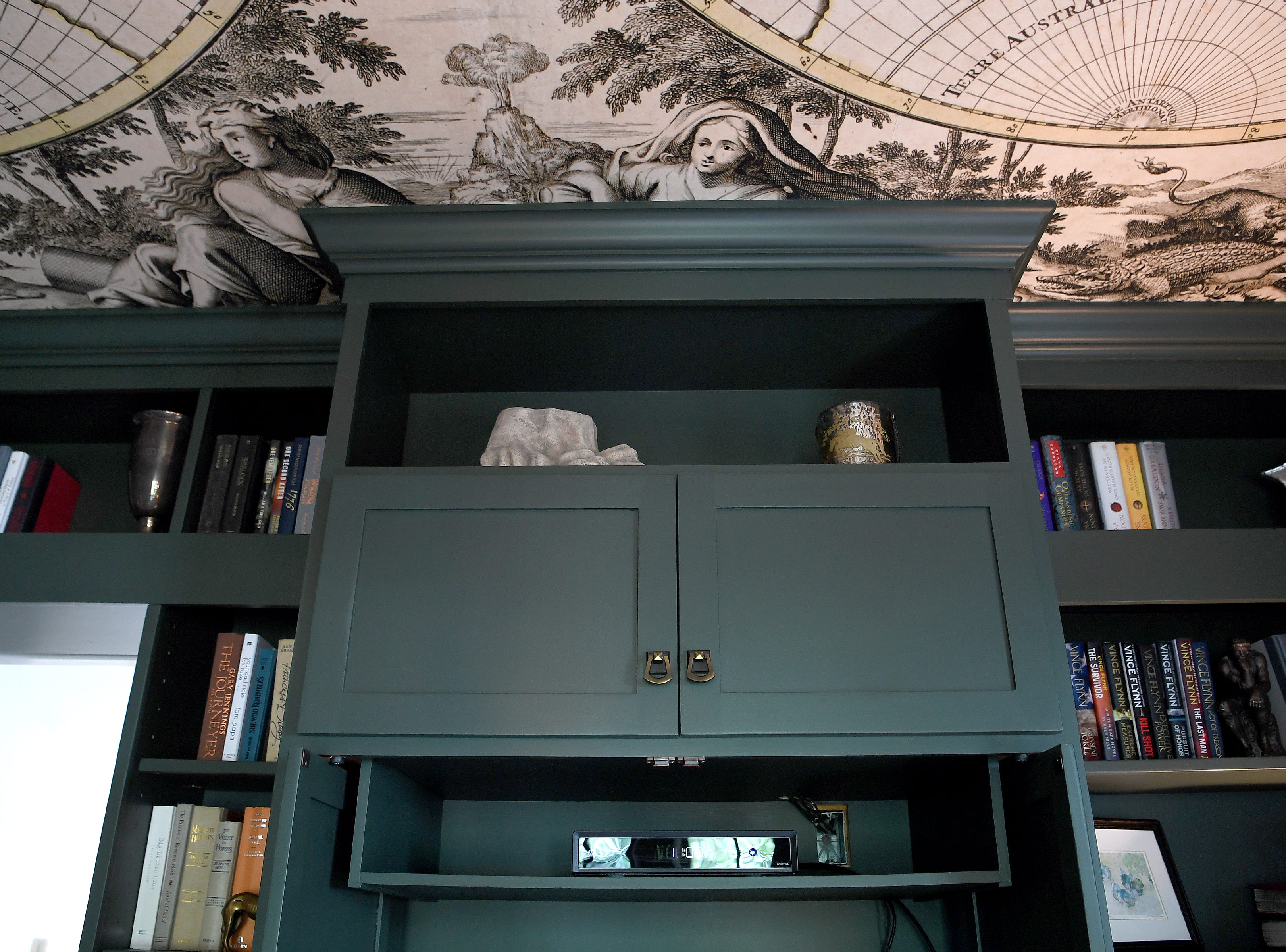 An antique-inspired world map papers the ceiling of the den of the Bryant family's North Asheville home.