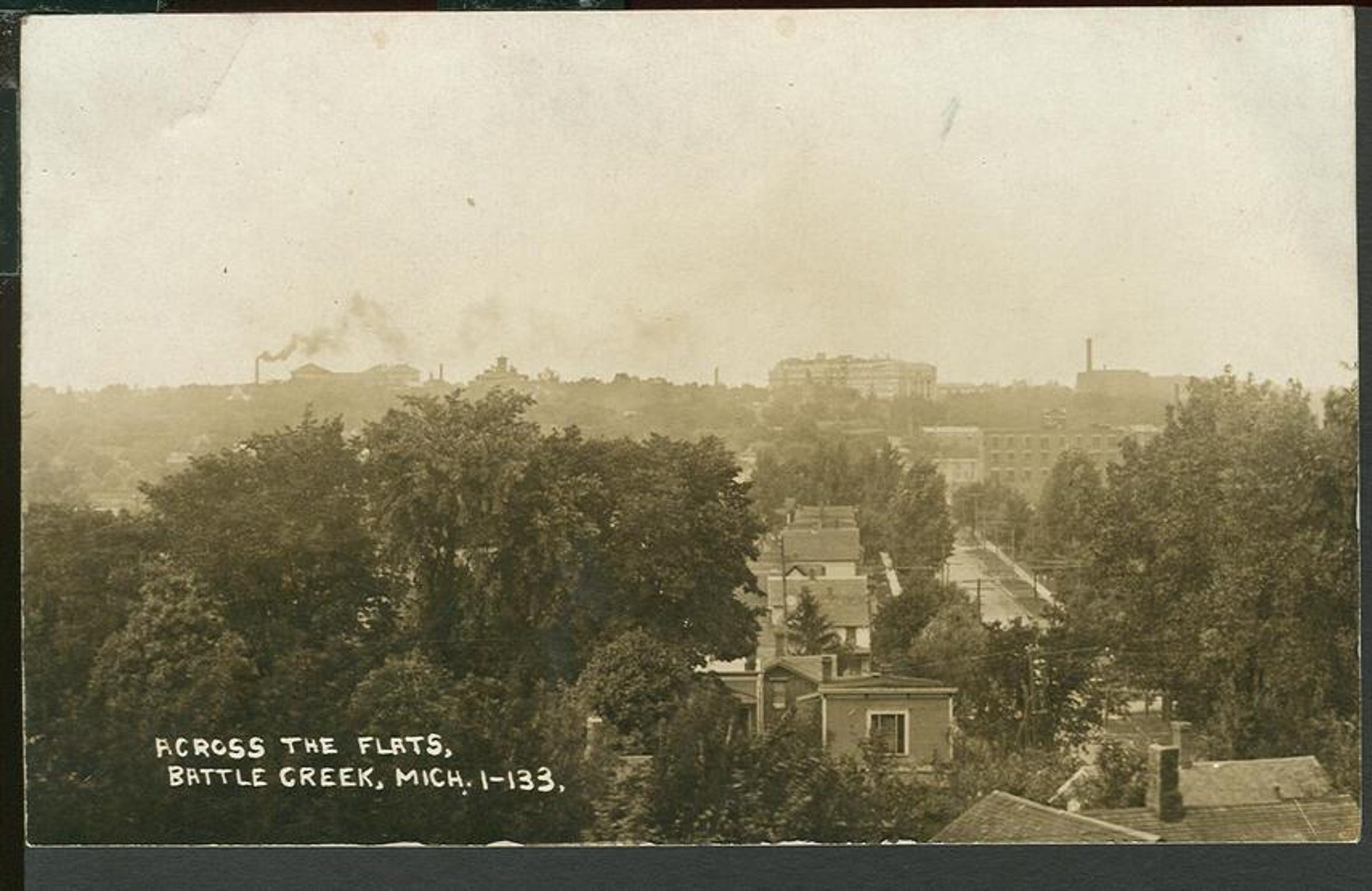 "An undated postcard showing a rooftop view of the industrial area known as the ""Flats"" in Battle Creek. The ""Flats"" would eventually become a neighborhood known as the ""Bottoms."""